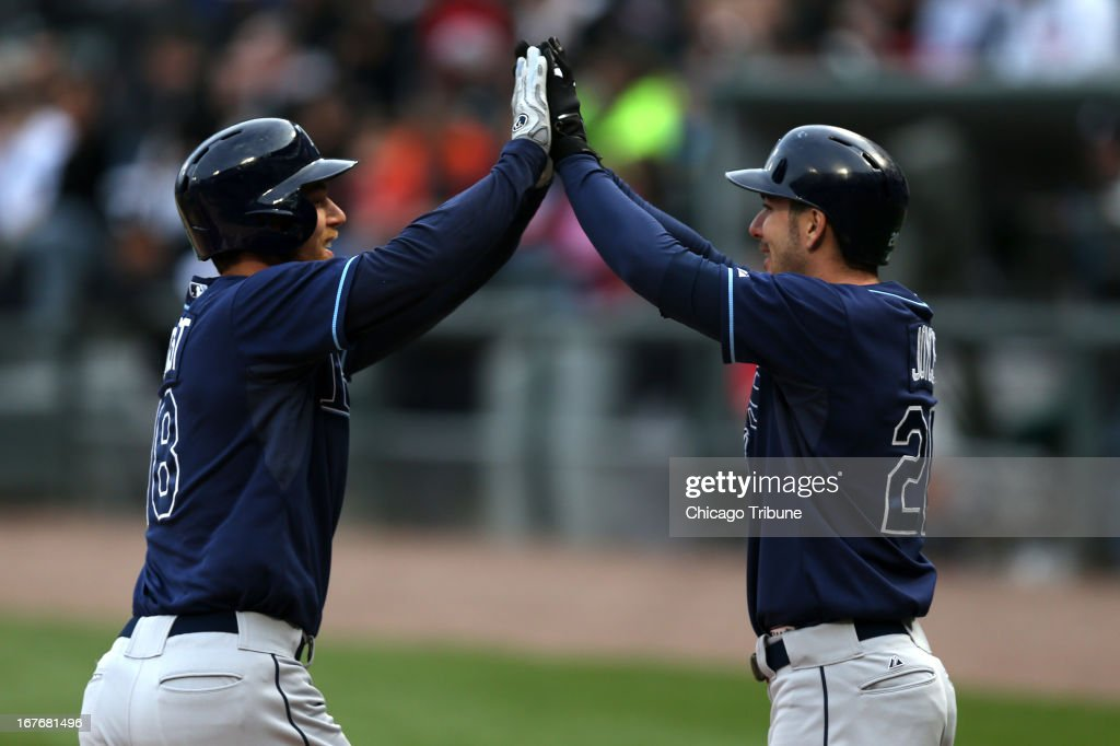 The Tampa Bay Rays' Ben Zobrist, left, celebrates with teammate Matt Joyce after Zobrist's two-run home run in the first inning against the Chicago White Sox at U.S. Cellular Field in Chicago, Illinois, on Saturday, April 27, 2013.