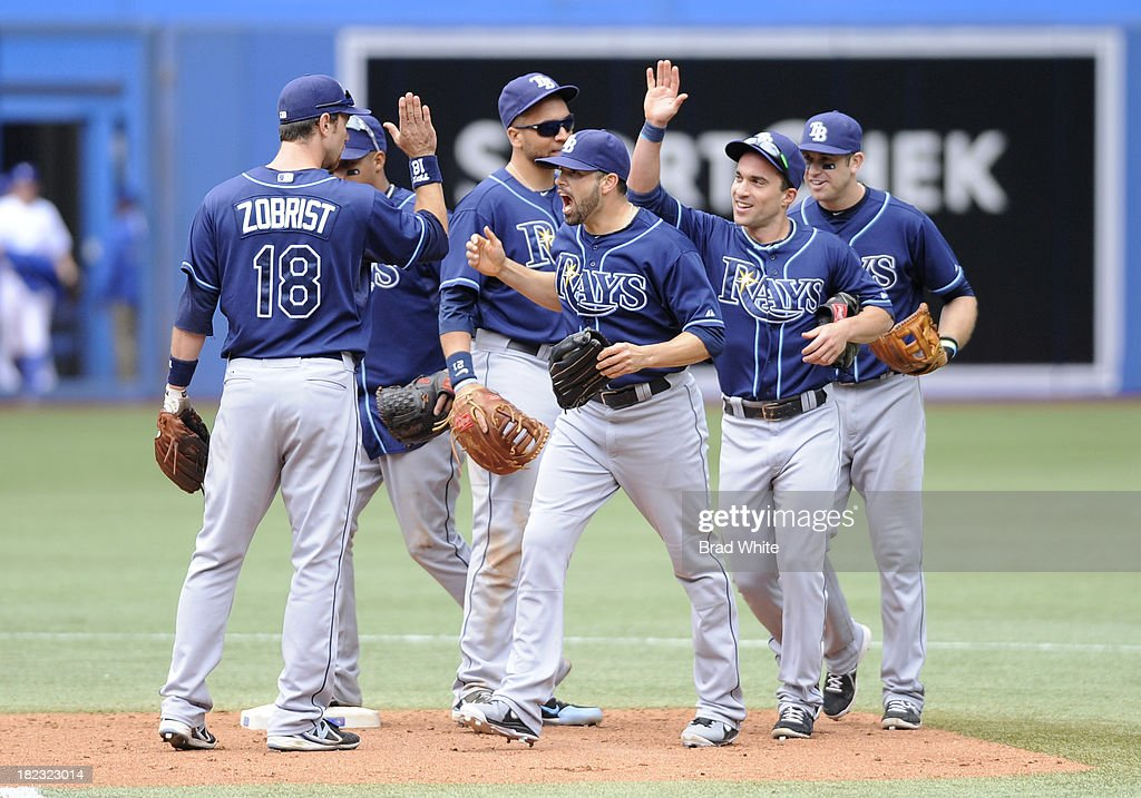 The Tampa Bay Rays celebrate the teams win over the Toronto Blue Jays during MLB game action September 29, 2013 at Rogers Centre in Toronto, Ontario, Canada.