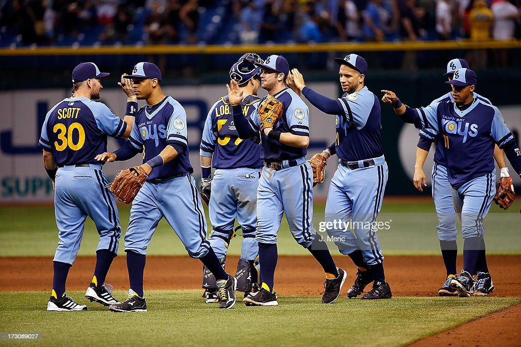 The Tampa Bay Rays celebrate their victory over the Chicago White Sox at Tropicana Field on July 6, 2013 in St. Petersburg, Florida.