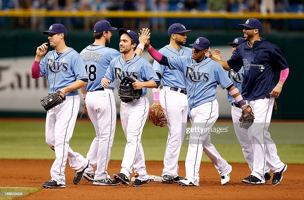 The Tampa Bay Rays celebrate their victory over the San Diego Padres at Tropicana Field on May 12, 2013 in St. Petersburg, Florida.