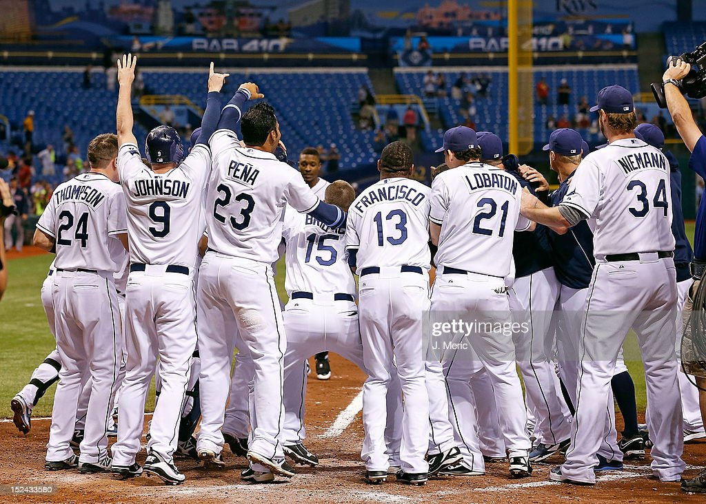 The Tampa Bay Rays celebrate victor over the Boston Red Sox at Tropicana Field on September 20, 2012 in St. Petersburg, Florida.