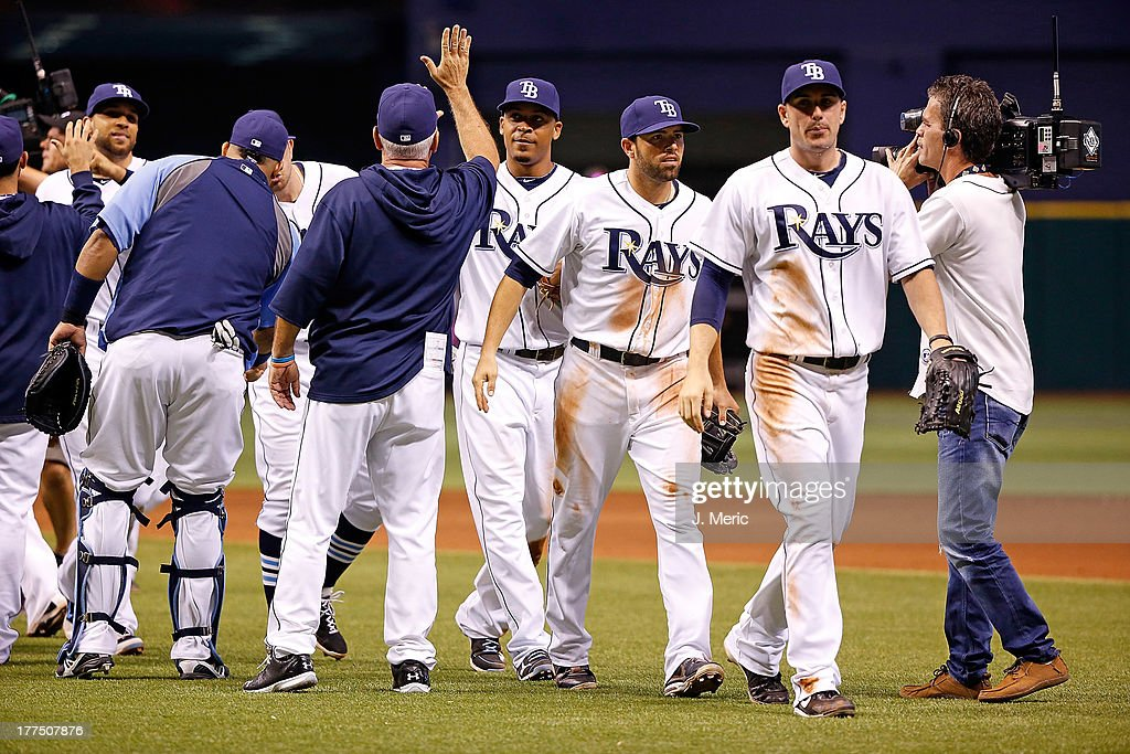 The Tampa Bay Rays celebrate victory over the New York Yankees at Tropicana Field on August 23, 2013 in St. Petersburg, Florida.