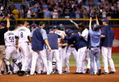 The Tampa Bay Rays celebrate victory over the San Francisco Giants at Tropicana Field on August 3 2013 in St Petersburg Florida