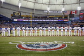 The Tampa Bay Rays stand for the national anthem during Opening Day ceremonies at the start of a game against the Toronto Blue Jays on March 31 2014...