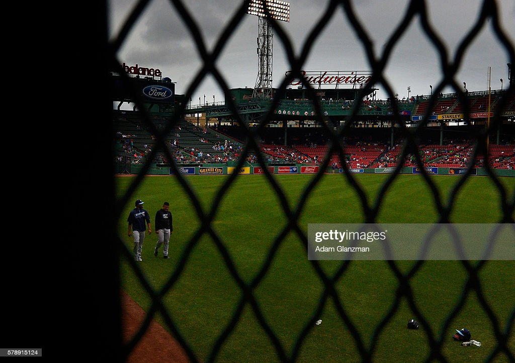 The Tampa Bay Rays walk along the green Monster prior to the game against the Boston Red Sox at Fenway Park on July 9 2016 in Boston Massachusetts