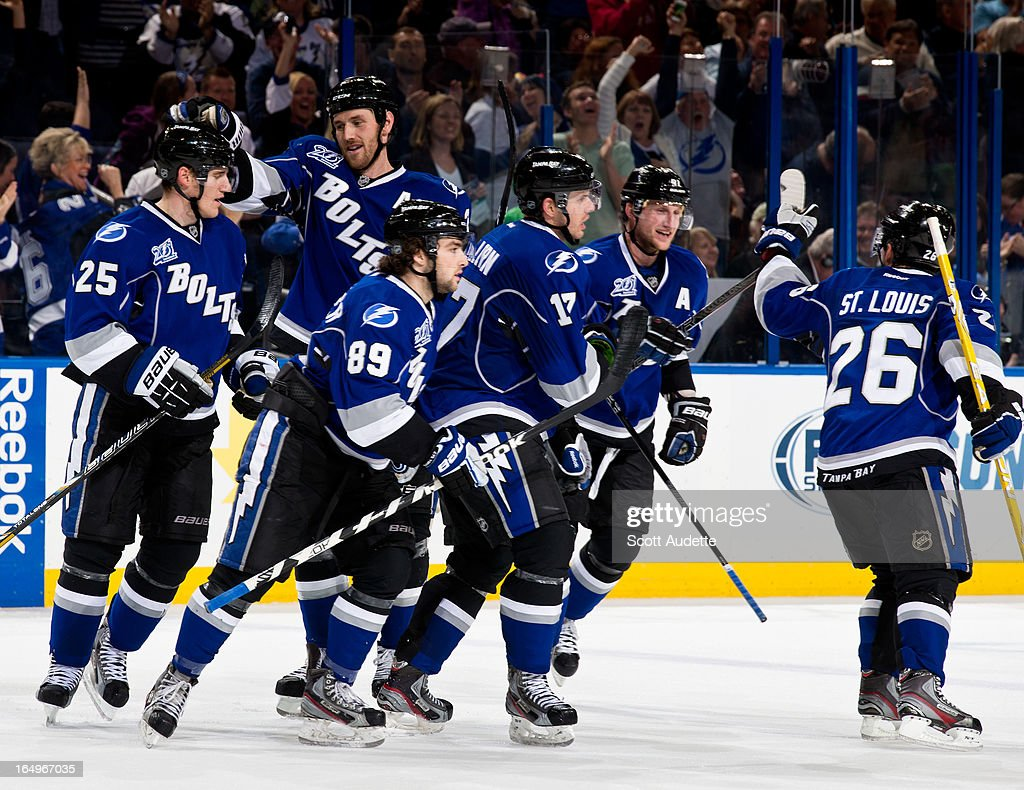 The Tampa Lightning celebrate after Alex Killorn #17 scores during the third period of the game at the Tampa Bay Times Forum on March 29, 2013 in Tampa, Florida. The second period wrapped up with a tie game, 2-2.