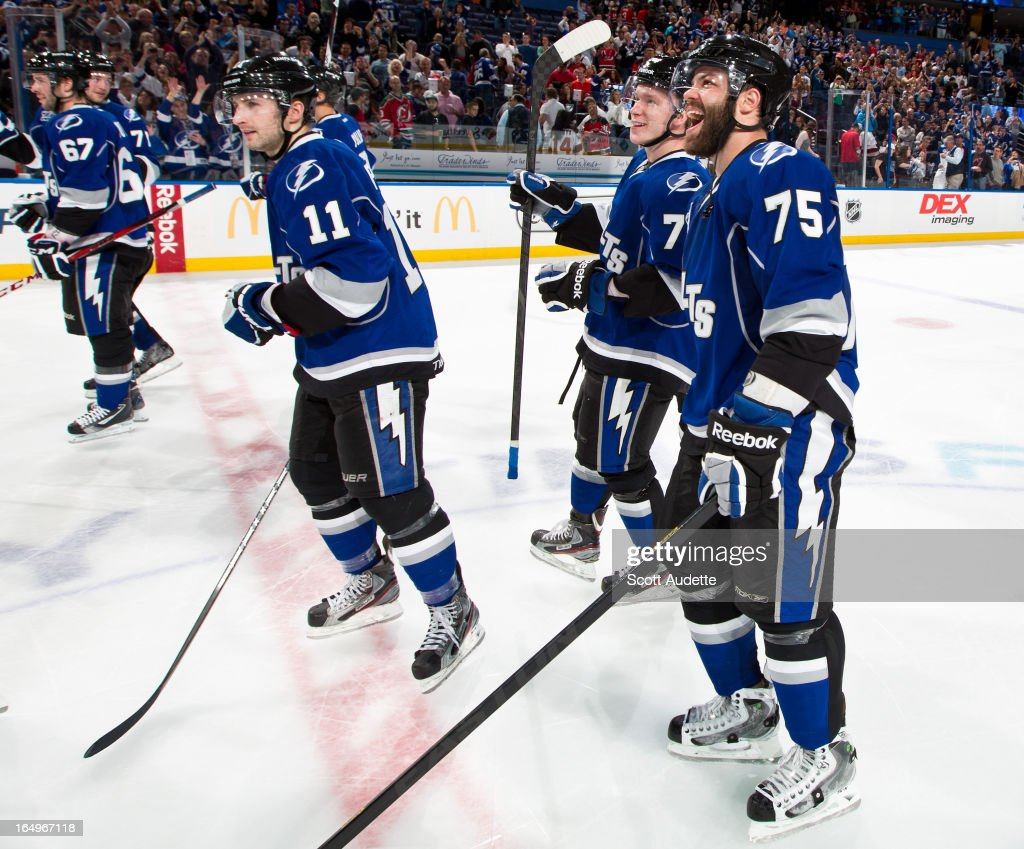 The Tampa Lightning celebrate defeating the New Jersey Devils 5-4 at the Tampa Bay Times Forum on March 29, 2013 in Tampa, Florida.