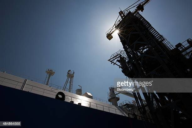 The Tangguh Palung liquefied natural gas tanker left operated by Tangguh LNG sits moored at the Korea Gas Corp LNG terminal in Tongyeong South Korea...