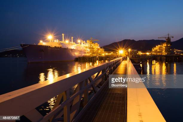 The Tangguh Palung liquefied natural gas tanker operated by Tangguh LNG unloads LNG via pipelines as it sits moored at night at the Korea Gas Corp...