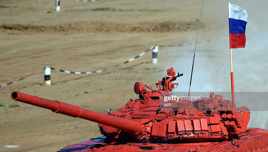 The tanks of Russian team competes during tank biathlon, a new paramilitary sport about armor races and precision gunnery near Alabino, outside Moscow, on August 17, 2013.