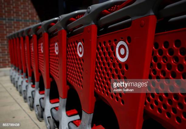 The Target logo is displayed on shopping carts outside of Target store on September 25 2017 in San Rafael California Target Corp annouced plans to...