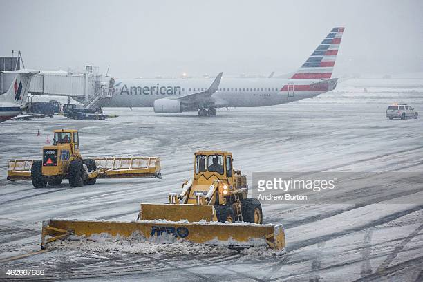 The tarmac of La Guardia Airport is cleared during a winter storm on February 2 2015 in the Queens borough of New York City The snowstorm which is...