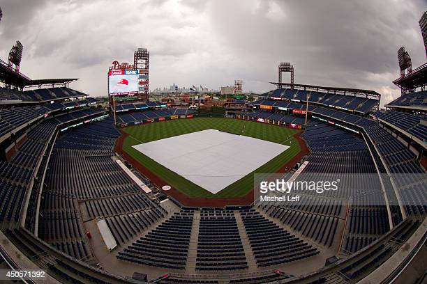 The tarp covers the field in anticipation for the incoming storm prior to the game between the Chicago Cubs and Philadelphia Phillies on June 13 2014...