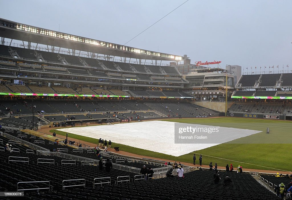 The tarp is shown on the field before the game between the Minnesota Twins and the Los Angeles Angels of Anaheim on April 17, 2013 at Target Field in Minneapolis, Minnesota. The game was postponed to a later date due to cold and rain.