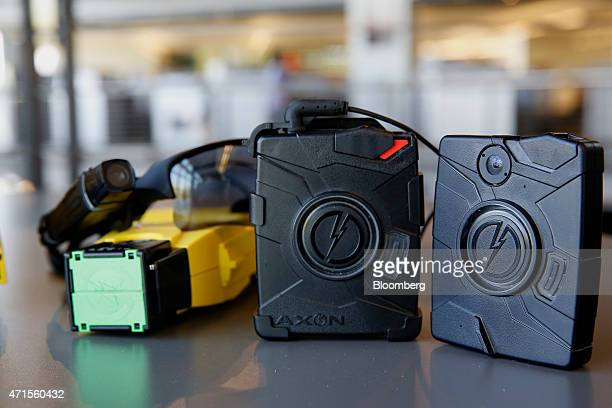The Taser X26 smart weapon and AXON police body cameras are arranged for a photograph at the Taser International Inc manufacturing facility in...