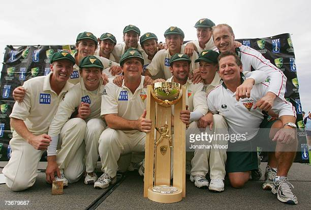 The Tasmanian Tigers pose for photographs with the Pura Cup Trophy after taking victory on day five of the Pura Cup Final between the Tasmanian...
