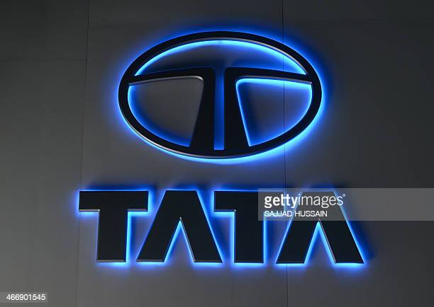 The Tata Motors logo is pictured during the 12th Auto Expo in Greater Noida on February 5 2014 AFP PHOTO/ SAJJAD HUSSAIN