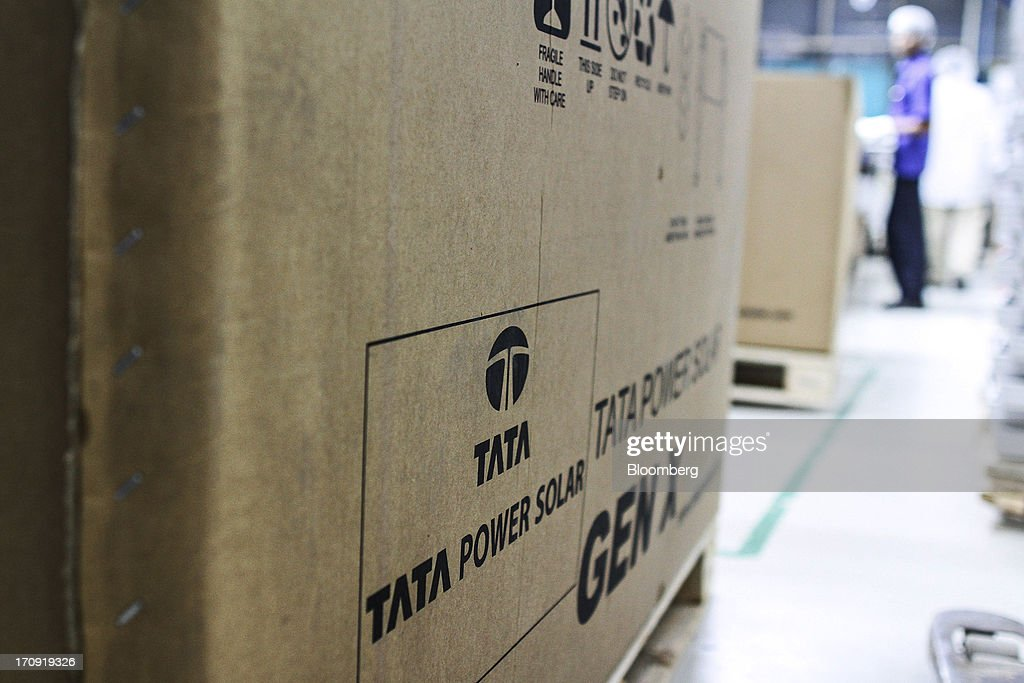 The Tata Power Solar Systems Ltd. logo is displayed on a box containing solar panels at the company's manufacturing plant in Bangalore, India, on Tuesday, June 11, 2013. Tata Groups solar unit is expanding its business building plants for customers, forecasting that offices and factories will be paying more for grid power than solar by 2016 in most Indian states. Photographer: Dhiraj Singh/Bloomberg via Getty Images