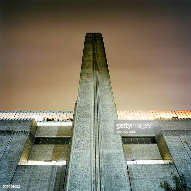 The Tate Modern art gallery illuminated at night