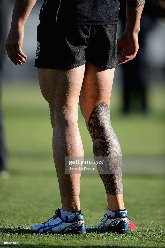 The tattooed leg of Sonny Bill Williams of New Zealand tackles team mate Kieran Foran during a New Zealand training session at the Parc des Sports Stadium on October 30, 2013 in Avignon, France.