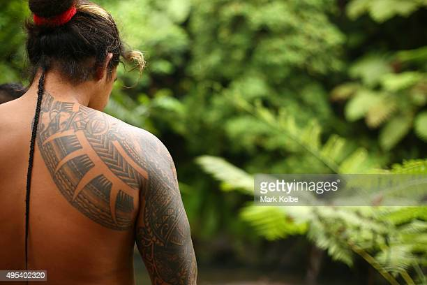 The tattoos of a local man are seen as he walks to the Togitogiga Waterfall in the O le PupuPue National Park on September 12 2015 near Poutasi Samoa