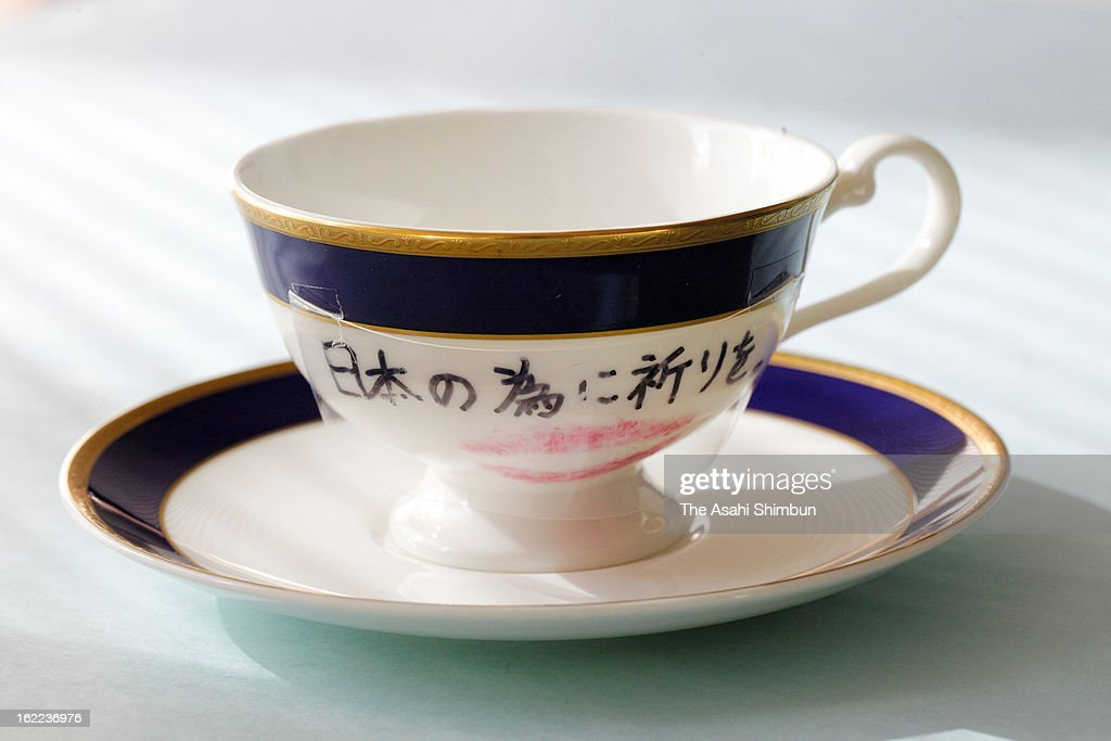 The tea cup an saucer that Lady Gaga auctioned for the Great East Japan Earthquake and following tsunami charity in June 2011, drawn 'Pray For Japan' in Japanese character are seen at Miyagi Prefecture headquarters on February 20, 2013 in Sendai, Miyagi, Japan. The successful bidder and dentist Akihisa Yumi, who had contributed to identify the victims of the quake and tsunami by checking the teeth marks, now in the hospital with Idiopathic Pulmonary Fibrosis, donated the cup that he spent approximately 6 million Japanese Yen, to Miyagi Prefecture in hope of the disaster not to be forgotten.
