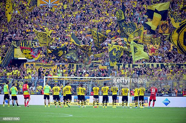 The team and the fans of Borussia Dortmund during the game between Borussia Dortmund and Hertha BSC on August 30 2015 in Dortmund Germany