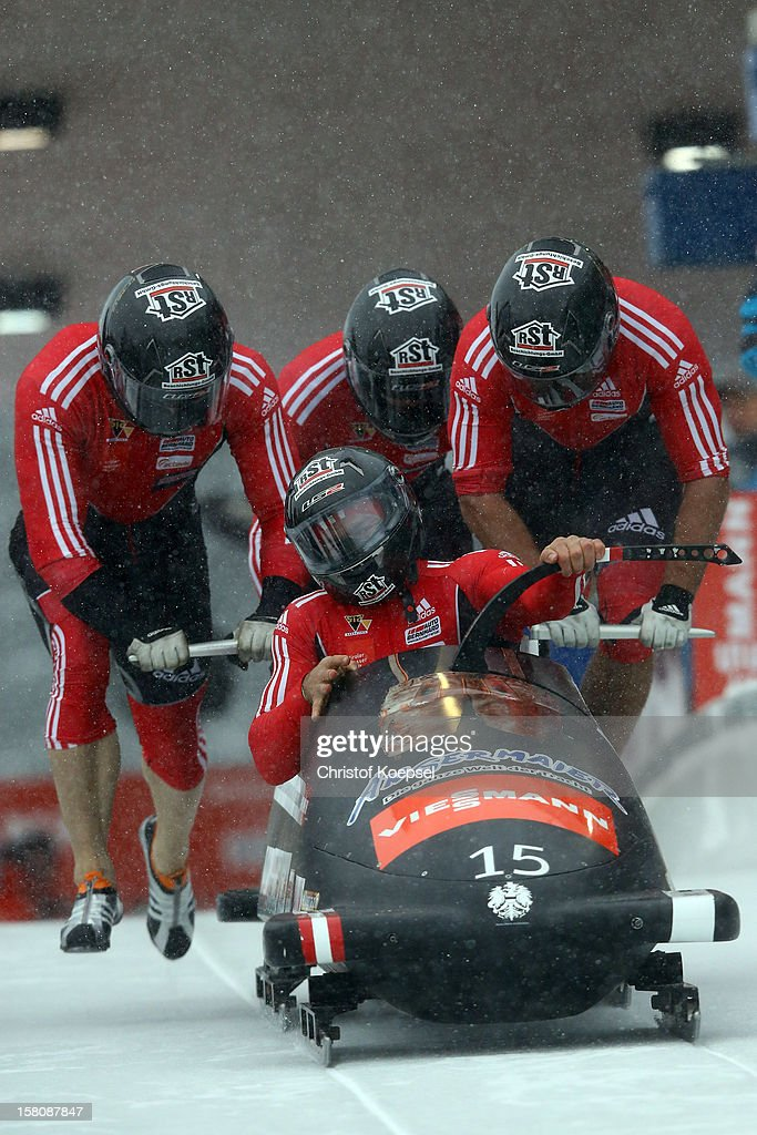 The team Austria 1 with Juergen Locker, Stefan Withalm, Matthias Adolf and Markus Sammer sprint during the four men's bob competition during the FIBT Bob & Skeleton World Cup at Bobbahn Winterberg on December 9, 2012 in Winterberg, Germany.