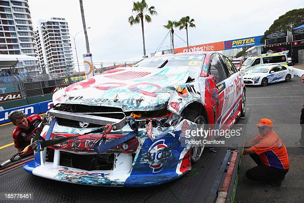 The Team BOC Holden driven by Andrew Jones returns to the pits after a crash during practice for the Gold Coast 600 which is round 12 of the V8...