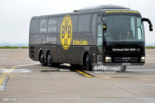 The team bus waits on the tarmac as the Borussia Dortmund return to Dortmund Airport after UEFA Champions League Final on May 26 2013 in Dortmund...