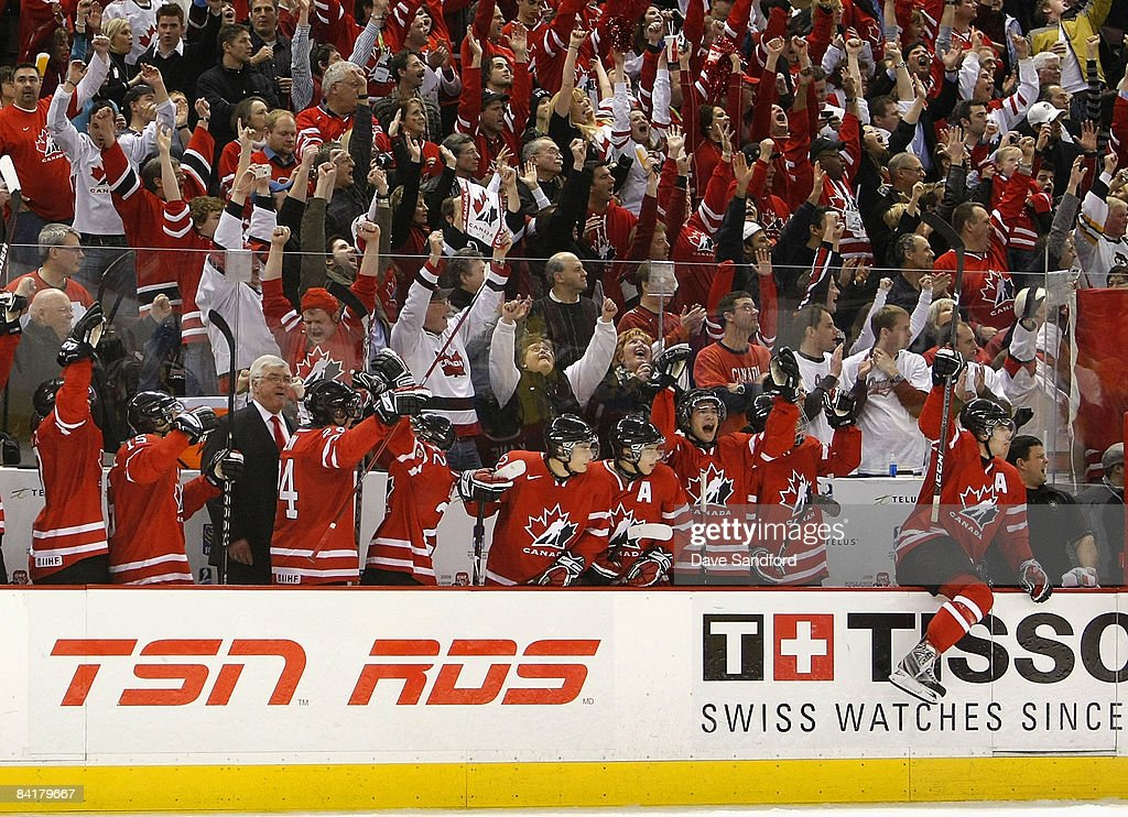 The Team Canada bench erupts as they score their 2nd empty net goal to seal their victory over Team Sweden during the 2009 IIHF World Junior...
