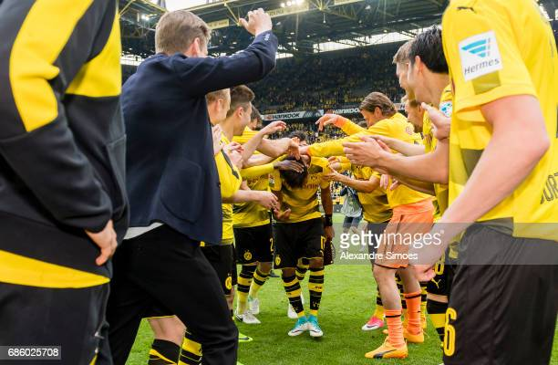 The team celebrates PierreEmerick Aubameyang of Borussia Dortmund for getting the trophy for being the top scorer of this season after the final...