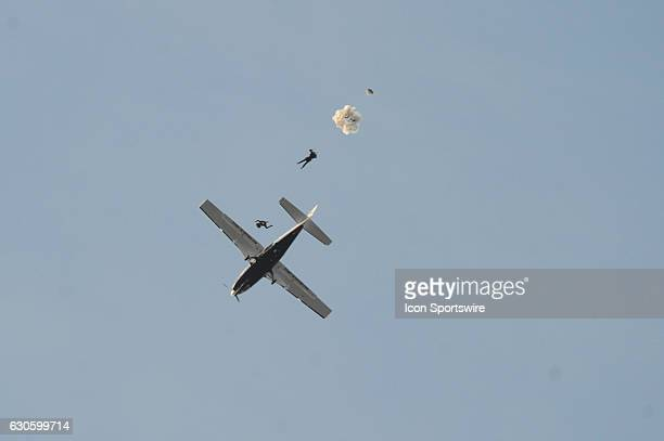 The Team Fastrax Parachute Jump Team exits their plane on December 27 at Navy Marine Corps Memorial Stadium in Annapolis MD in the Military Bowl