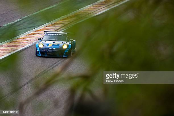 The Team Felbermayr Proton Porsche 911 RSR driven by Christian Ried of Germany Gianluca Roda of Italy and Paolo Ruberti of Italy in action during the...