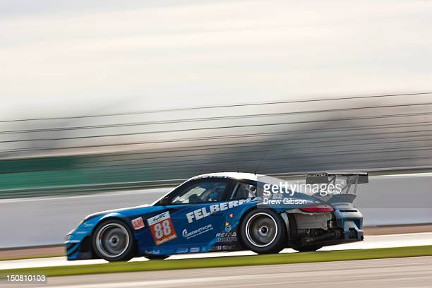 The Team Felbermayr Proton Porsche 911 RSR driven by Christian Ried of Germany Gianluca Roda of Italy and Paolo Ruberti of Italy during the 2012 FIA...