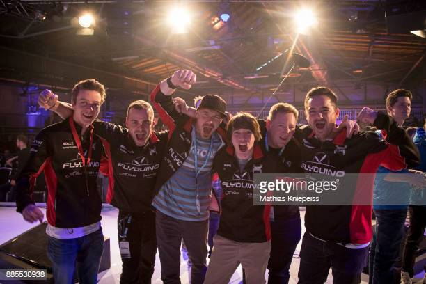 The team Flyduino which wins todays race celebrates at Station Berlin during the DCL Drone Champions League Championship Finals in Berlin on December...