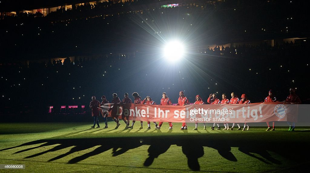 The team fo FC Bayern Munich thanks their supporters with a banner which reads ' Thank you You are wonderfull' after the German first division...