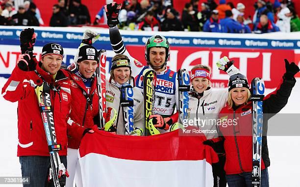 The team from Austria comprising of Fritz Strobl Benjamin Raich Marlies Schild Mario Matt Michaela Kirchgasser and Renate Goetschl celebrate after...