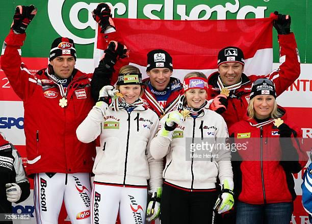 The team from Austria comprising of Mario Matt Marlies Schild Benjamin Raich Michaela Kirchgasser Fritz Strobl and Renate Goetschl celebrate with...