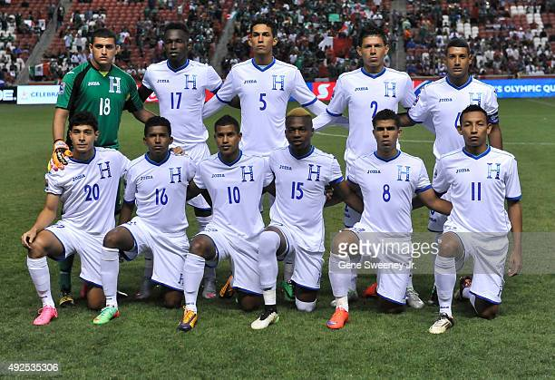The team from Honduras poses for a photo before their game against Mexico during the final CONCACAF Olympic Qualifying match at Rio Tinto Stadium on...