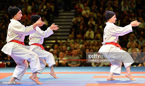 The team from Iran competes during the women's third place Kata competion of the 22nd Karate World Championships at OVBArena on November 9 2014 in...