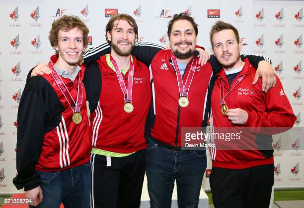 The team from Masque de Fer a local Gatineau fencing club celebrates their gold medals won during the Senior Men's Team Epee event on April 21 2017...