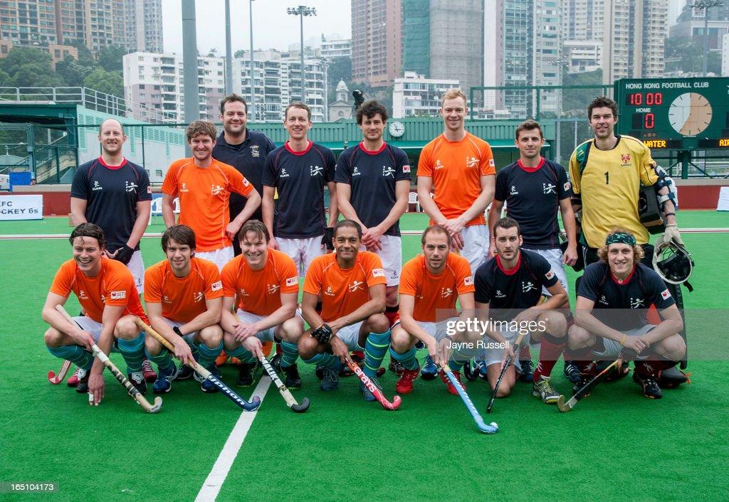 The team group shot of the Air Team (Holland) and the Water Team (Great Britain) pose during Day Three of the 2013 Hong Kong 6's at Hong Kong Football Club on March 30, 2013 in Hong Kong, Hong Kong.