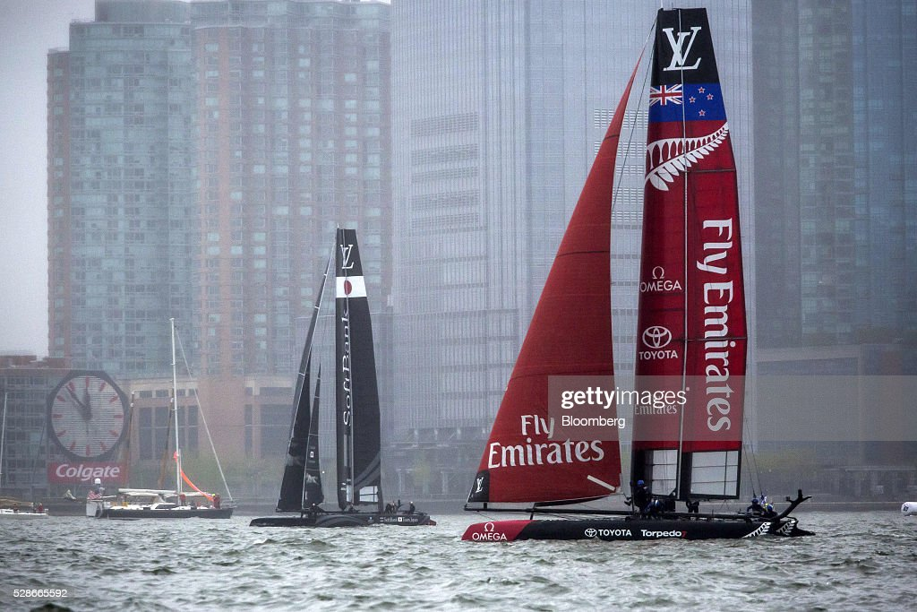 The Team Japan, left, and Emirates Team New Zealand, right, catamarans sail during practice for the Louis Vuitton America's Cup World Series sailing races in New York, U.S., on Friday, May 6, 2016. The America's Cup sailing races are held in New York City on the Hudson River for the first time since 1920. Photographer: Michael Nagle/Bloomberg via Getty Images