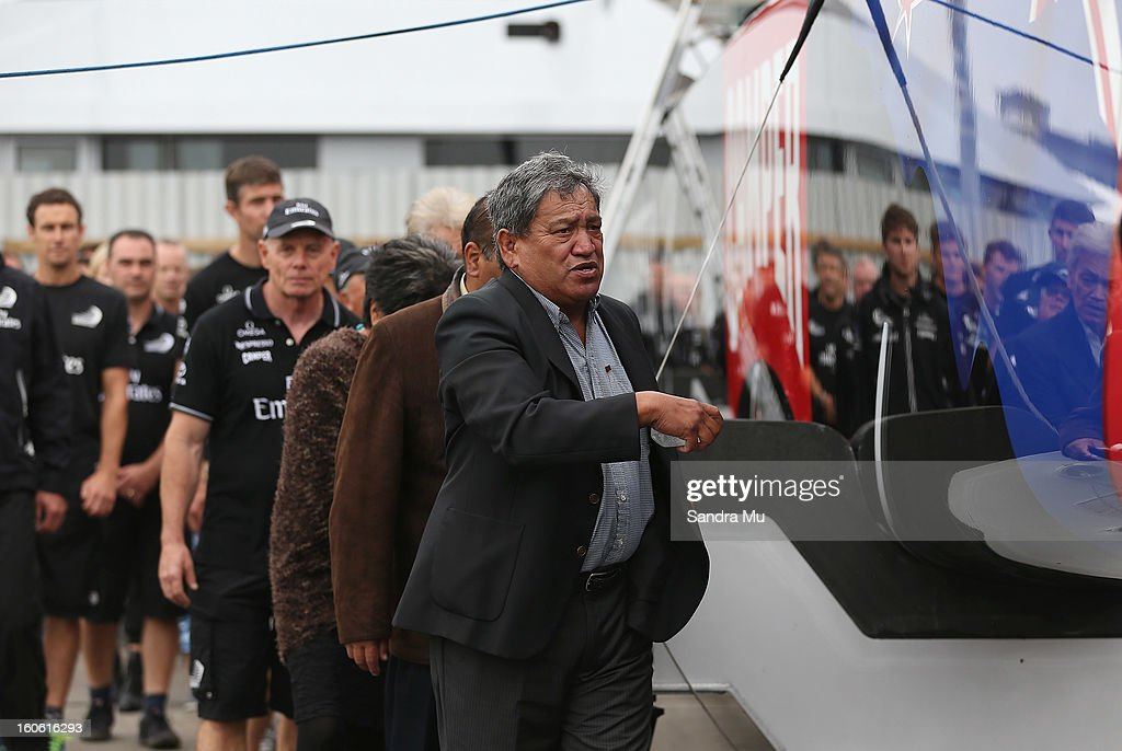 The Team New Zealand crew follow Matt Maihi, Kaumatua of Ngati Whatua Orakei as he blesses the boat during the launch of the Emirates Team New Zealand boat at the Viaduct Harbour on February 4, 2013 in Auckland, New Zealand.