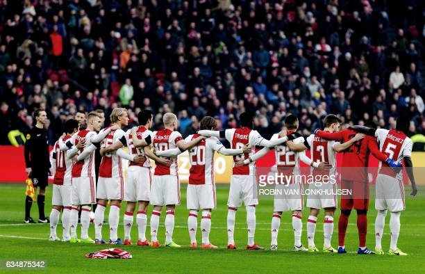 The team of Ajax Amsterdam keeps one minute of silence prior to the Dutch Eredivisie football match against Sparta in Amsterdam on February 12 to...