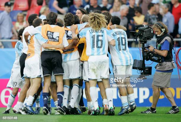 The Team of Argentina celebrates for a tv camera after the winning Semi Final match between Mexico and Argentina for the FIFA Confederations Cup 2005...