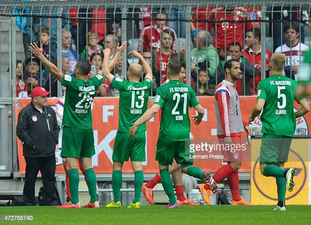 The team of Augsburg celebrates the opening goal during the Bundesliga match between FC Bayern Muenchen and FC Augsburg at Allianz Arena on May 9...