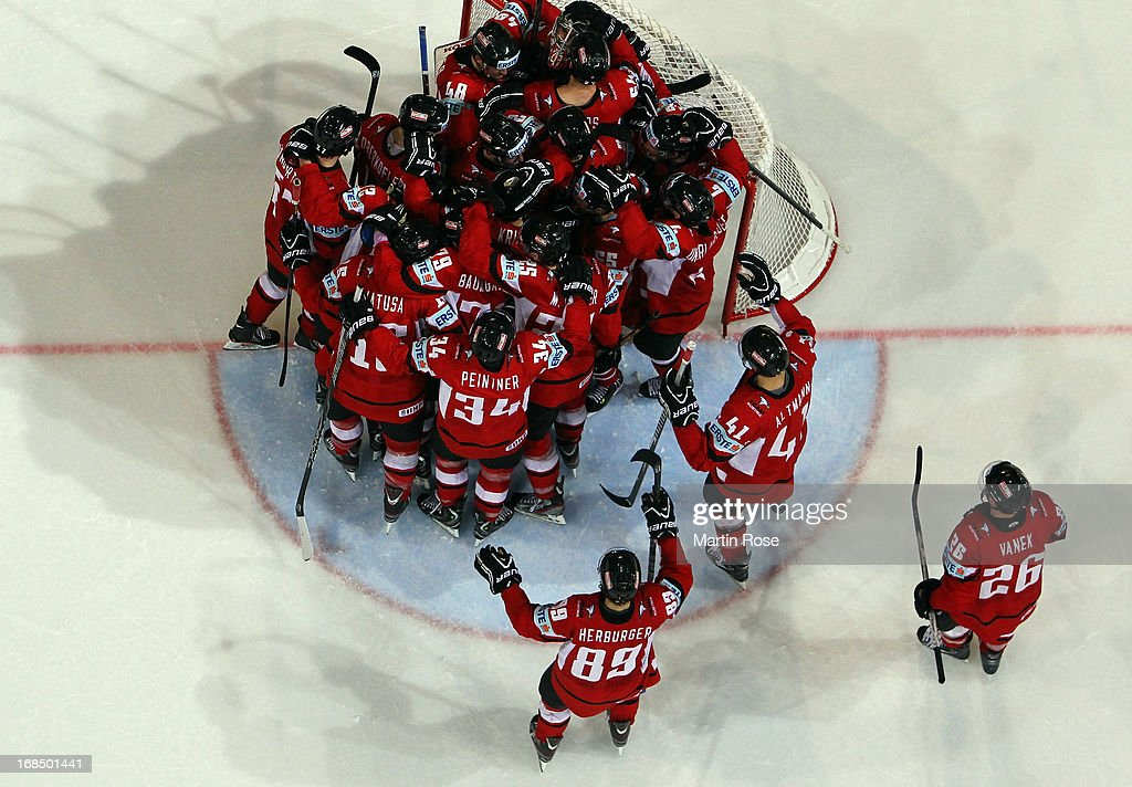 The team of Austria celebrate after the IIHF World Championship group H match between Slovakia and Austria at Hartwall Areena on May 10, 2013 in Helsinki, Finland.