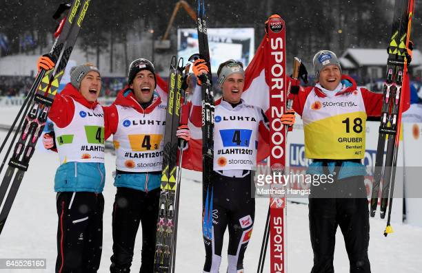 The team of Austria celebrate after the Men's Nordic Combined Team HS 100 4 x 50km CrossCountry Sprint during the FIS Nordic World Ski Championships...